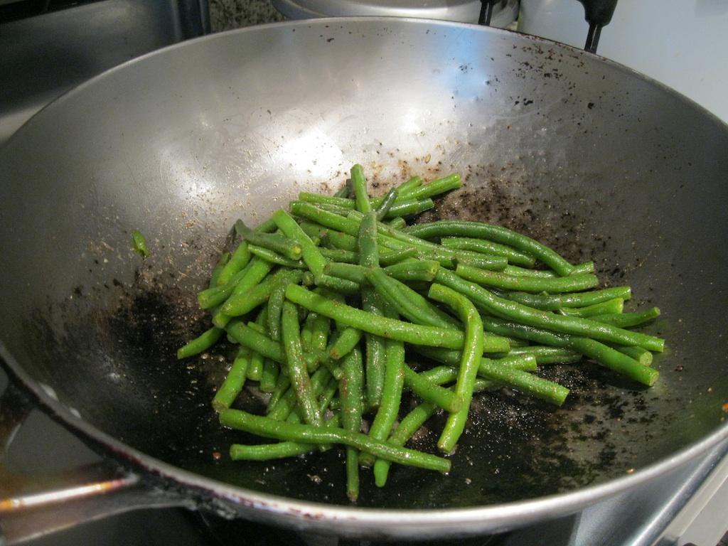 Tossing beans in garam masala butter